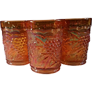 Marigold Carnival Glass Tumblers in the Grape Pattern made by Indiana Glass