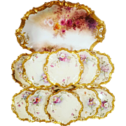 12 Piece Antique French Limoges Handpainted Floral Dessert Set with 1 Large Oval Platter & 11 Dessert Plates Signed by Mulville Color Pink/Red/White Roses and Gold Edging