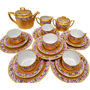 Tea Service For 6 - Set Includes 6 Trios with Tea Coffee Pot, Creamer, Sugar Bowl,  Gold Encrusted With Hand Painted Floral Rims, German Porcelain MH (Heinrich) Co. Pink,Lavender, White, Blue roses, daisies and vines in a trellis