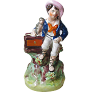 Victorian Staffordshire Figure of a Boy Hurdi Gurdi player with Monkey