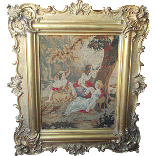 Victorian needlepoint in a fine giltwood frame.