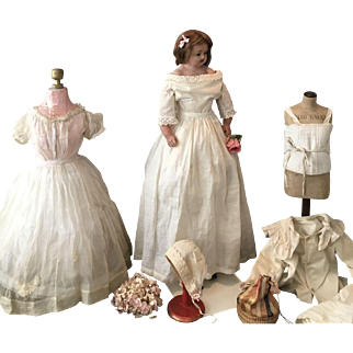 Very Large Antique Pure Wax Doll with  various  Dresses and Clothes