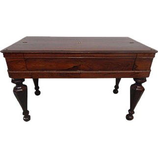 Antique rose wood piano spinnet desk .