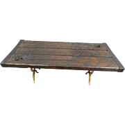 Antique ship hatch door coffee table on brass legs
