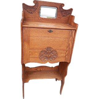 Antique oak secretary desk with beveled mirror