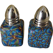 Artistic unique salt and pepper shakers