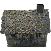 Vintage Pressed Steel Gingerbread House Bank