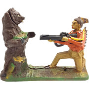 "Book of Knowledge Series ""The Indian and the Bear"" Mechanical Bank"