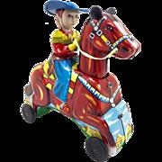 Galloping Cowboy Tin Toy