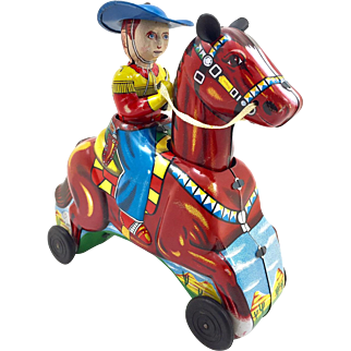 Galloping Cowboy Tin Toy