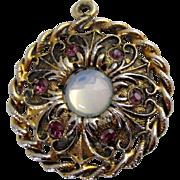 Circular Textured Gold Tone Opalescent Stone Purple Rhinestone Pendant Vintage