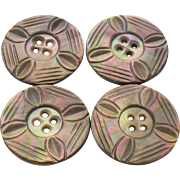 A vintage set of Four Hand carved Mother of pearl buttons - Red Tag Sale Item