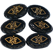 6 Victorian pressed black glass buttons with gold tone accents