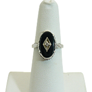 Vintage 10KT white gold and onyx diamond ring.