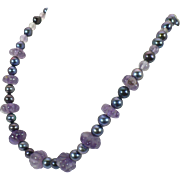 Amethyst melon bead and black freshwater pearl necklace with 14 KT white gold clasp