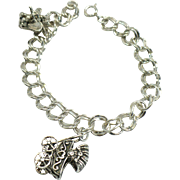 Vintage Sterling 7.5 charm bracelet with 2 sterling charms