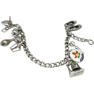 Vintage Sterling charm bracelet with eight vintage sterling charms