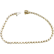 Vintage Classic straight line 14 kt gold and diamond tennis bracelet, 1.50 CTW