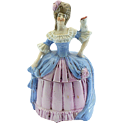 Brunette dresser doll with a cockatoo on her arm