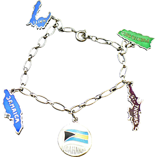 Vintage silver charm bracelet with enameled island charms