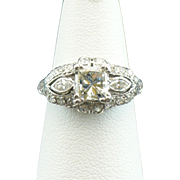 Princess cut diamond in a vintage platinum and diamond semi-mount