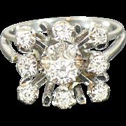"""14 karat white gold vintage """"Snowflake"""" ring."""
