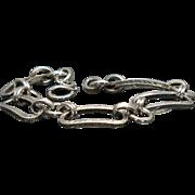 Vintage sterling bracelet with engraved links