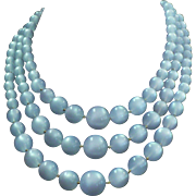Vintage triple strand pale blue Moonglow bead necklace by Richelieu
