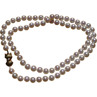 Vintage 23 inch cultured Mikimoto pearl strand with 14 kt clasp
