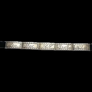 Vintage WWII Sterling sweetheart/forget not bracelet on a black velvet ribbon