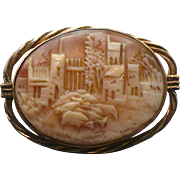 Vintage cattle grazing by city Cameo brooch