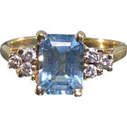Vintage 14 karat Blue topaz and diamond ring