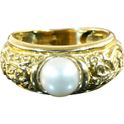 Vintage 18 karat gold and pearl ring
