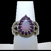 Custom 14 karat white gold Opal and Rhodolite garnet ring