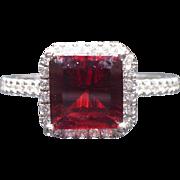 Garnet and diamond ring in 14 karat gold