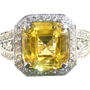6.23 CT Yellow Sapphire and diamond ring in 14 karat white gold.