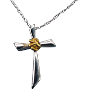 Petite 14 karat white gold cross with a natural gold nugget and on an 18 inch table