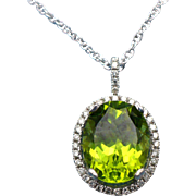 2.60 ct Oval Peridot and diamonds 14 karat white gold pendant and 18 inch chain