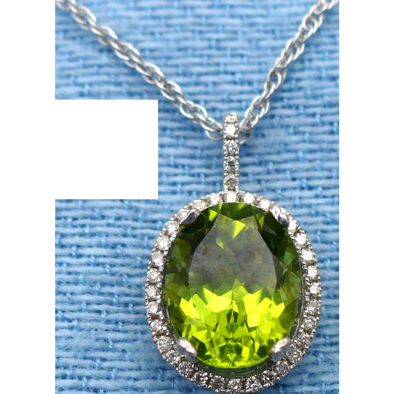 2.60 ct Oval Peridot and diamonds 14 karat white gold pendant