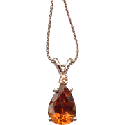 Precious Topaz in 14 karat white gold with a diamond