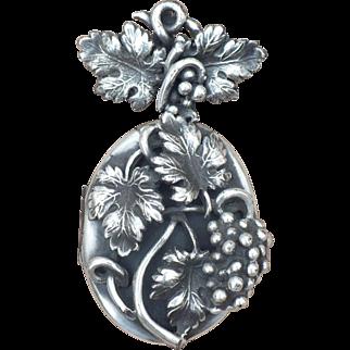 Vintage Corocraft silvertone locket and pin with grape motif