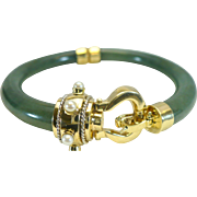 Vintage jade bangle bracelet in 14 karat yellow and white gold, and with cultured Akoya pearls