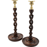 Pair of English Edwardian oak, open barley twist candlesticks