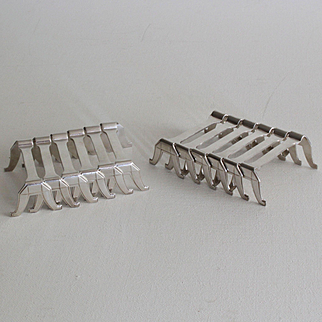 French Art Deco set of 12 elegant silver plated knife holders.