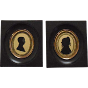 A pair of middle 19th miniatures : 2 silhouettes portraits.