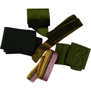 An assortment of 5 ancient pieces ribbons : shades of green.