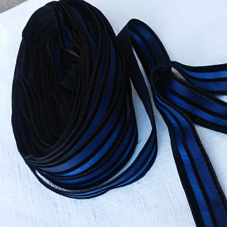 France late 19th century:29' 6'' 5/1 of a beautiful black velvet and two tone deep blue silk satin ribbon.