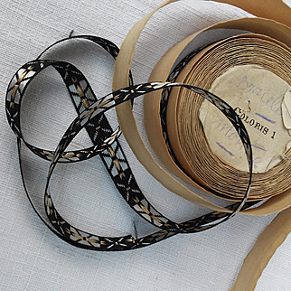 Two lengths of French ribbon on its original cardboard roll : Circa 1925.