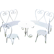 Adorable doll's garden furniture in the manner of Peynet .