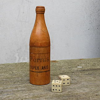 France circa 1930:small advertising wooden bottle with 2 dice.
